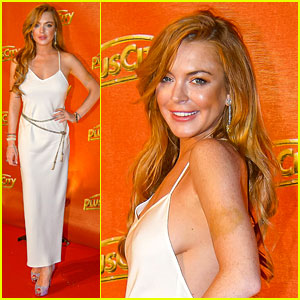 Lindsay Lohan Flashes Some Side Boob at Austria's White Party