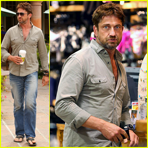 Gerard Butler Scopes Out Surf Gear After Kissing Session with Mystery Girl