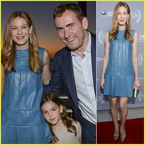 Happily married husband and wife: Peter White and Michelle Monaghan with their daughter Willow at the opening night tribute for the San Diego Film Festival 2014