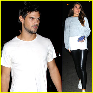 Taylor Lautner Brings Along a Friend for Drake Concert!