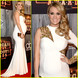 Carrie Underwood Accentuates Her Growing Baby Bump in a Tight Dress at American Country Countdown Awards 2014!