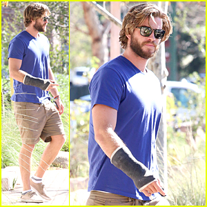 Liam Hemsworth Is Still Wearing Cast Before Valentine's Day