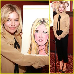 Sienna Miller Shows Off Her Caricature Portrait at Sardi's