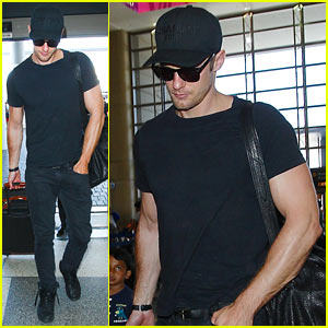 Alexander Skarsgard Muscles Up to Depart Los Angeles