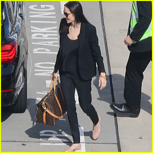 Angelina Jolie Catches Post-Birthday Flight with Son Pax