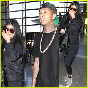 Kylie Jenner & Tyga Wear Matching Black at LAX Airport