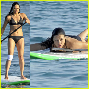 Michelle Rodriguez Wears Knee Bandage While Paddleboarding in Her Bikini in Italy