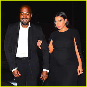 Kanye West Can Barely Contain His Smile with Kim Kardashian