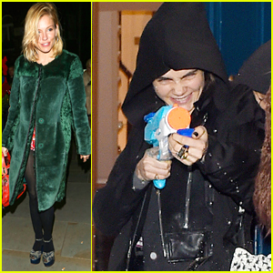 Cara Delevingne & St. Vincent Spray Paparazzi With Water Guns