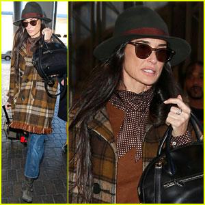Demi Moore Bundles Up in Plaid for Paris Flight
