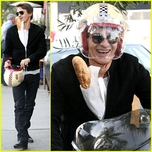 Olivier Martinez Rides Motorcycle with Baguette in His Jacket