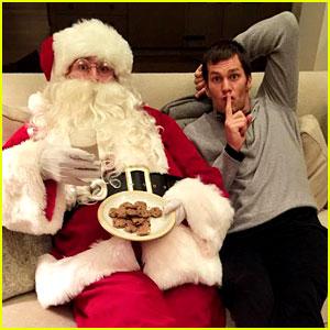Tom Brady Poses with Mystery Santa - Is it Gisele Bundchen?!
