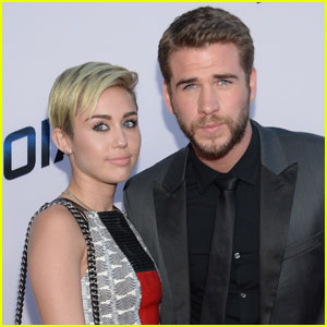 Miley Cyrus & Liam Hemsworth Spotted 'Cuddling & Kissing' in Australia - Report