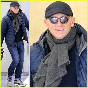 Daniel Craig Arrives Back Home with a Smile!