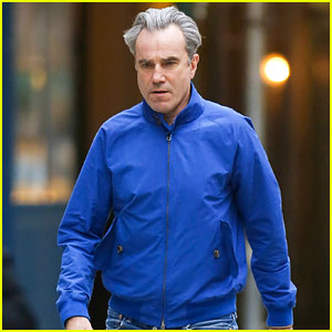 Daniel DayLewis wears a bright blue windbreaker while walking back to