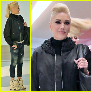 Gwen Stefani Poses With An Interesting Tabloid at Airport