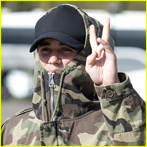 Justin Bieber Camouflages Himself For London Arrival Ahead of BRIT Awards 2016