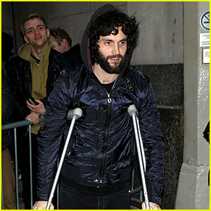 Penn Badgley Walks Around on Crutches in New York City