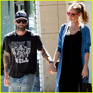 Behati Prinsloo Shows Off Tiny Baby Bump with Adam Levine