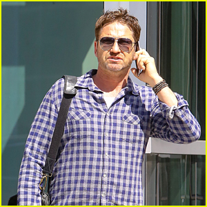 Gerard Butler Takes Call on His Way to Business Meeting