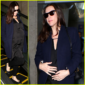 Pregnant Liv Tyler Cradles Her Baby Bump at the Airport