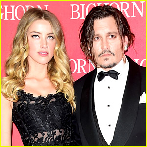 Amber Heard Shares Photo of Bruised Face, Claims Johnny Depp Tried to Pay Her Off