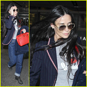 Demi Moore Reps Mickey Mouse for Airport Arrival