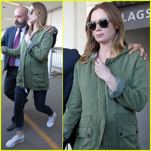 Emily Blunt Keeps Her Baby Bump Covered at LAX