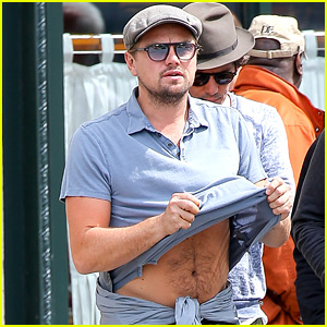 Leonardo DiCaprio Lifts His Shirt & Flashes Some Skin!