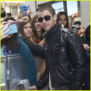 Nick Jonas Stops For Pics With Fans in Madrid