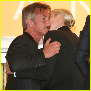Sean Penn & Charlize Theron Share a Kiss While Leaving 'The Last Face' Premiere
