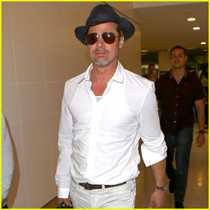 Brad Pitt Wears All White for His LAX Arrival