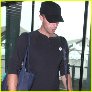 Chris Martin Jets Out of London While on Tour With Coldplay