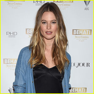 Behati Prinsloo Shows Off Bare Baby Bump by the Pool!