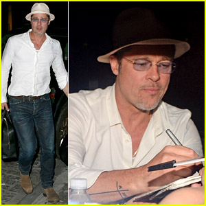 Brad Pitt Lands in New York & Signs Autographs for Fans
