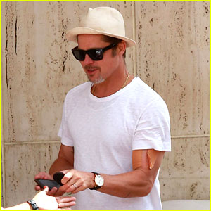 Brad Pitt Sports an Arm Bandage While Shopping with Maddox