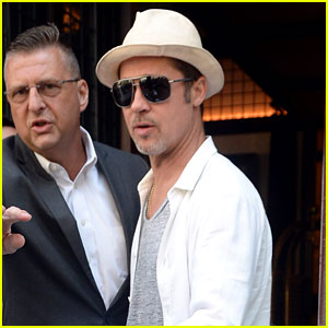 Brad Pitt Leaves His Hotel with Security By His Side