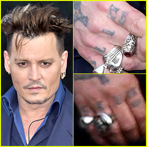 Johnny Depp Changes Amber Heard Tattoo to 'Scum'