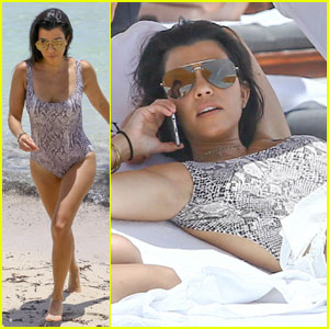 Kourtney Kardashian Soaks Up the Sun in Snake Skin One-Piece