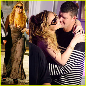Mariah Carey Teases the Camera in A Glittery Gold Bikini!