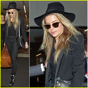 Amber Heard Emerges at LAX After Divorce Settlement