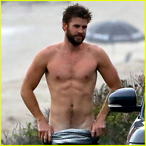 Liam Hemsworth Bares Ripped Abs While Stripping Out of Wetsuit