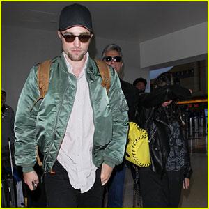 Robert Pattinson & FKA twigs Catch a Flight Out of Los Angeles