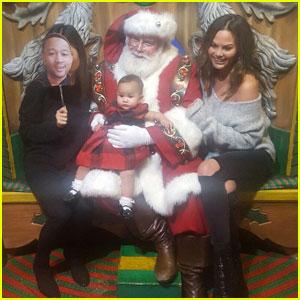 Chrissy Teigen Takes Baby Luna To Get Photos With Santa & John Legend Cardboard Cutout