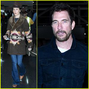 Dylan McDermott & Maggie Q Head Through JFK Airport With Their Dog