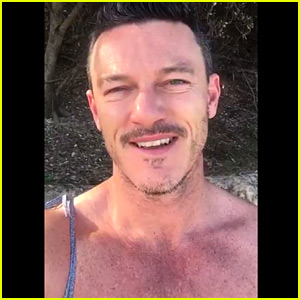 Luke Evans Is Shirtless on the Beach for His Christmas Video!