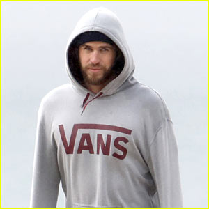 Liam Hemsworth Bundles Up While Checking Out the Surf