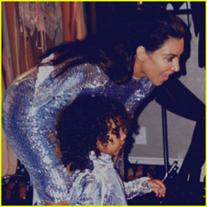 Kim Kardashian & North West Sparkle in Matching Dresses at Kanye West's Show