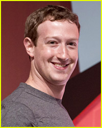 Mark Zuckerberg Works Out with His Baby Strapped to His Back