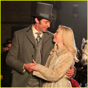 Hugh Jackman & Michelle Williams Share a Kiss on 'The Greatest Showman' Set